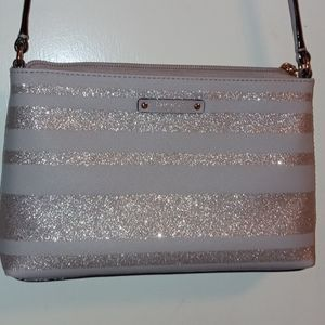 Kate Spade bag with strap.
